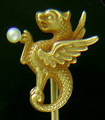 Alling basilisk and pearl stickpin. (J9025)
