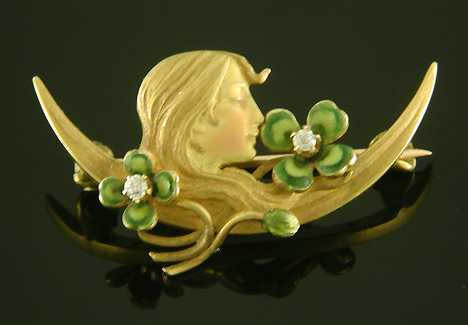 Krementz Art Nouveau brooch of dreaming woman and clover. (J9090)