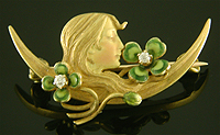 Krementz Art Nouveau brooch of serene woman and clover. (J9090)