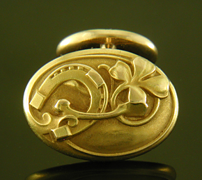 Larter Art Nouveau lucky cufflinks crafted in 14kt gold. (9533)