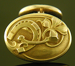 Larter Art Nouveau lucky cufflinks crafted in 14kt gold. (9190)