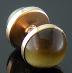Sansbury & Nellis Tiger Eye cufflinks crafted in 14kt gold. (J9207)