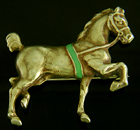 Sloan & Co. horse brooch with green enamel accent. (J9114)