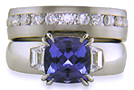 Custom tanzanite and diamond engagement ring and wedding band.