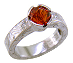 Hand-engraved Spessartitie Garnet ring.