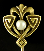 Egyptian Revival stickpin set with a luminous pearl. (J9033)